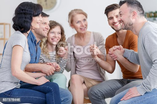 istock Support group praying 837378446