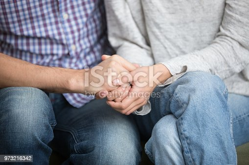 Support in marriage concept, close up view of couple holding hands expressing sympathy and hope, overcoming problems together, fertility treatment, reconciliation and understanding in relationships