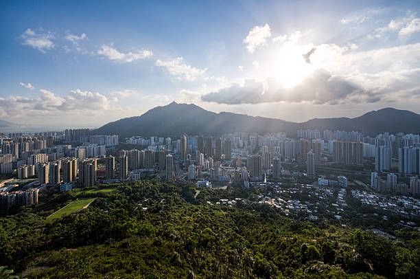 Tuen Mun, Hong Kong Sunset at Tuen Mun in Hong Kong, Castle Peak at the behind. new territories stock pictures, royalty-free photos & images