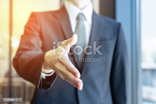 istock Support of business concept. Shaking hands. 1035881212