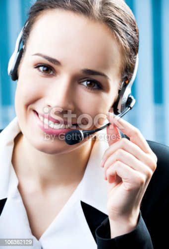 1167562098 istock photo Support phone operator in headset at workplace 106362129