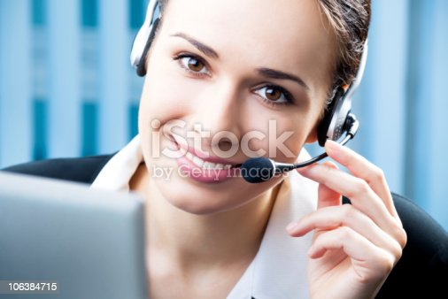 1167562098 istock photo Support phone operator in headset at workplace 106384715