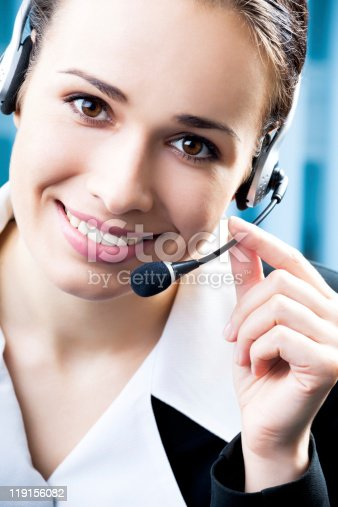 1167562098 istock photo Support phone operator in headset at workplace 119156082