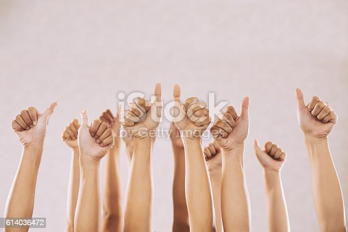 Hand of people showing thumbs-up to express their support