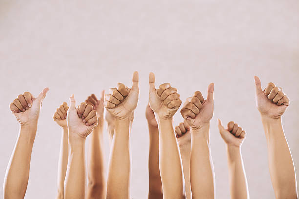 Support Hand of people showing thumbs-up to express their support encouragement stock pictures, royalty-free photos & images