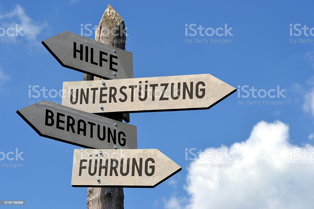 Support signpost - in German stock photo
