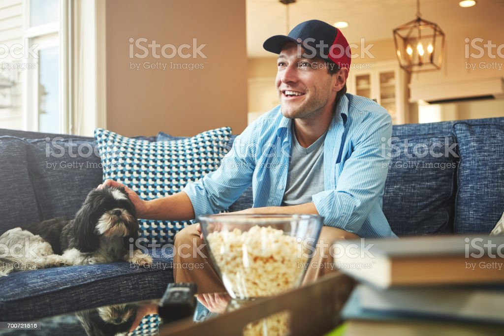 Support the sport from the sofa stock photo