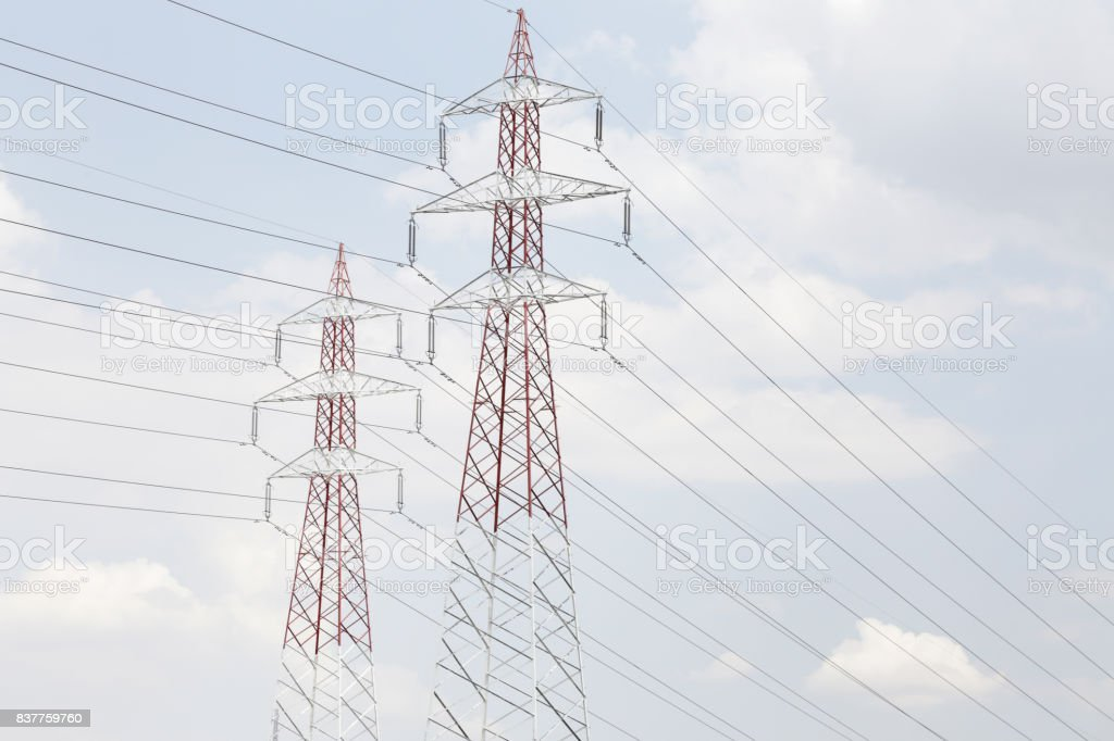 Support with electric wires against the blue sky. stock photo