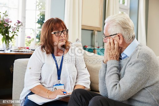 874789476istockphoto Support Worker Visits Senior Man Suffering With Depression 874794186