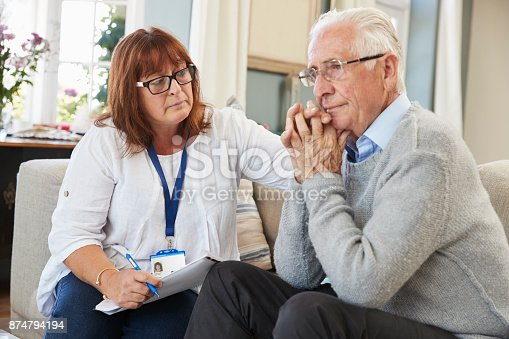 874789476istockphoto Support Worker Visits Senior Man Suffering With Depression 874794194
