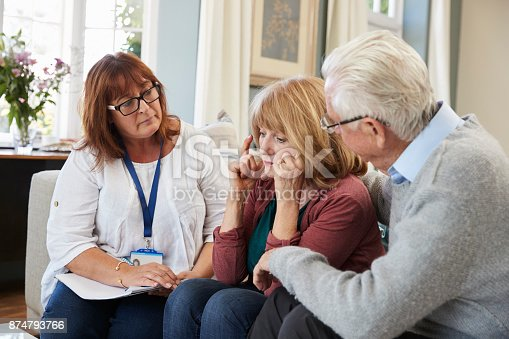 874789476istockphoto Support Worker Visits Senior Woman Suffering With Depression 874793766