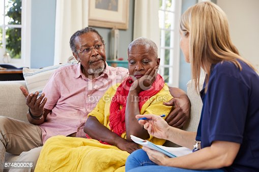 874789476istockphoto Support Worker Visits Senior Woman Suffering With Depression 874800026