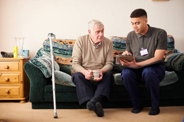 support worker with client stock photo