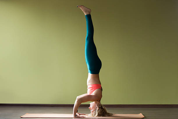 Royalty Free Yoga Handstand Pictures, Images and Stock ...