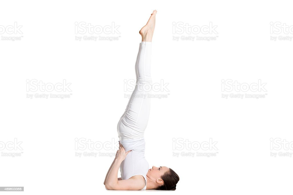 Supported Shoulderstand yoga asana stock photo