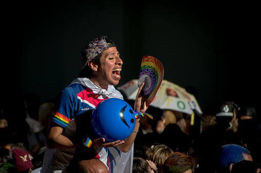 A supporter sings along to music at Gay Pride in Buenos Aires