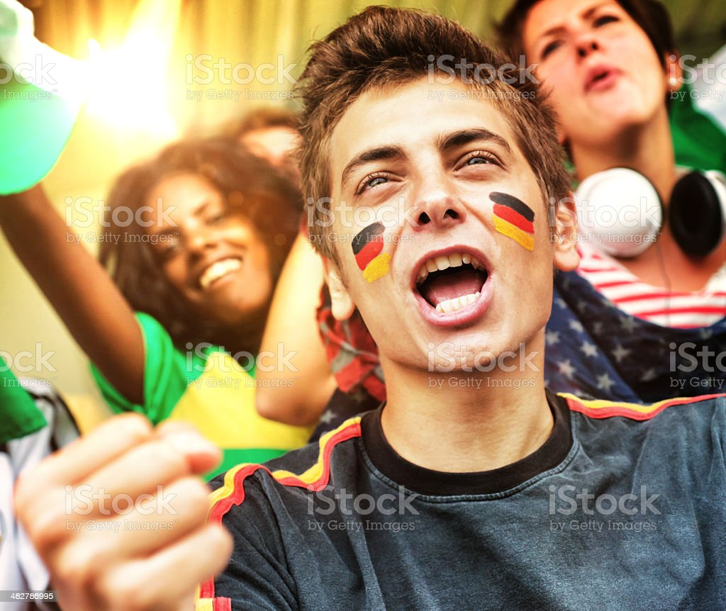 Supporters at Stadium. German Fan in Foreground royalty-free stock photo