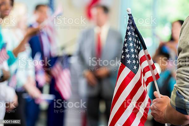 Supporters waving american flags at political campaign rally picture id600414802?b=1&k=6&m=600414802&s=612x612&h=jpz7ca8do1v4uabhevzuc7ymohfusfsugygi4 z7bqc=