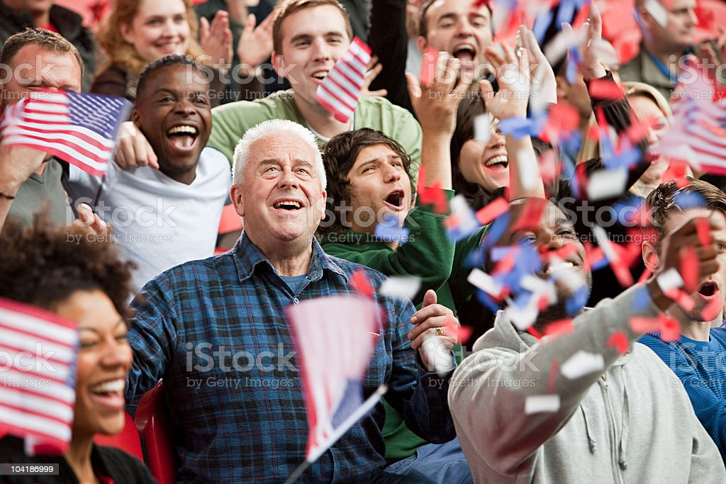 USA supporters with flags and ticker tape stock photo