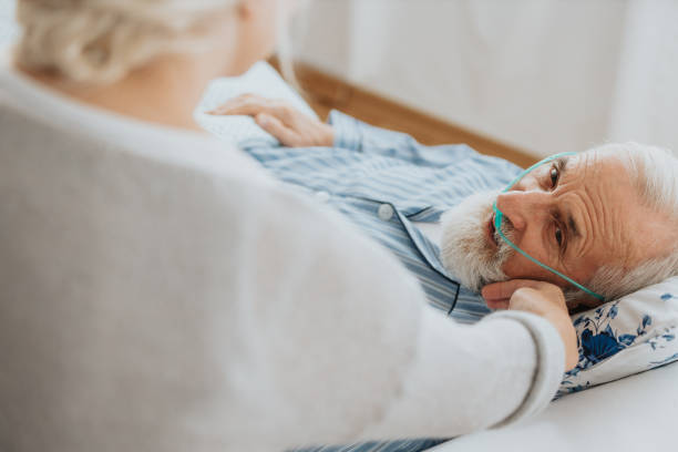Supporting dying husband stock photo