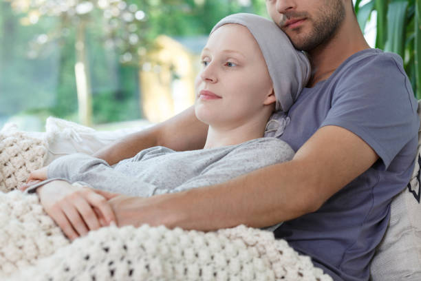 Supporting tired wife after chemotherapy stock photo