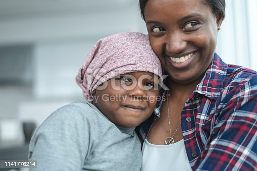 637119208 istock photo Supportive mother holds child with cancer 1141776214