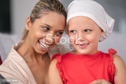 637119208 istock photo Supportive mother holds child with cancer 1176674638