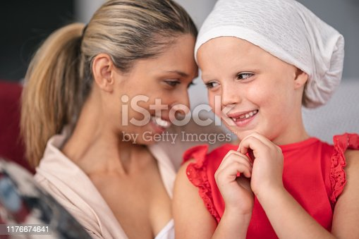 637119208 istock photo Supportive mother holds child with cancer 1176674641
