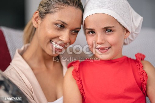 637119208 istock photo Supportive mother holds child with cancer 1176674659