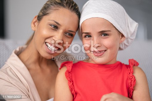 637119208 istock photo Supportive mother holds child with cancer 1176910207