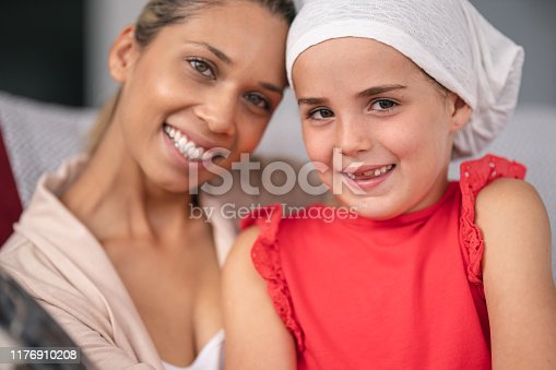637119208 istock photo Supportive mother holds child with cancer 1176910208
