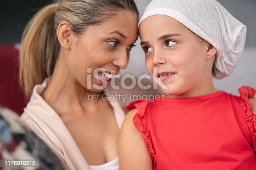 637119208 istock photo Supportive mother holds child with cancer 1176910212