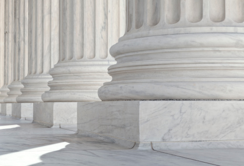 istock U.S. Supreme Court Architectural Detail of Base of the Columns 184352238