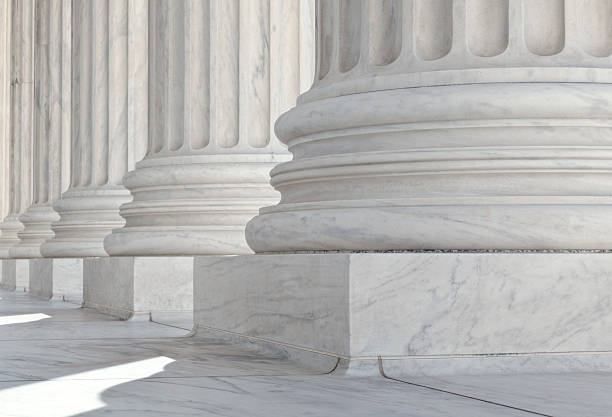 u.s. supreme court architectural detail of base of the columns - stability stock photos and pictures