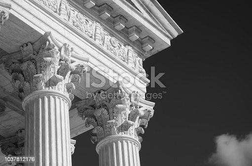 Close-up in black and white of the classically detailed US Supreme Court building in Washington, DC, USA