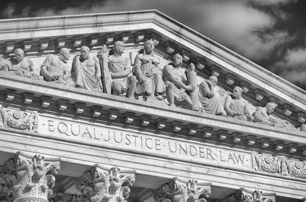 """US Supreme Court Building Detail Close-Up Close-up in black and white of the message """"Equal Justice Under Law"""" inscribed in the classically detailed US Supreme Court building in Washington, DC, USA us supreme court building stock pictures, royalty-free photos & images"""
