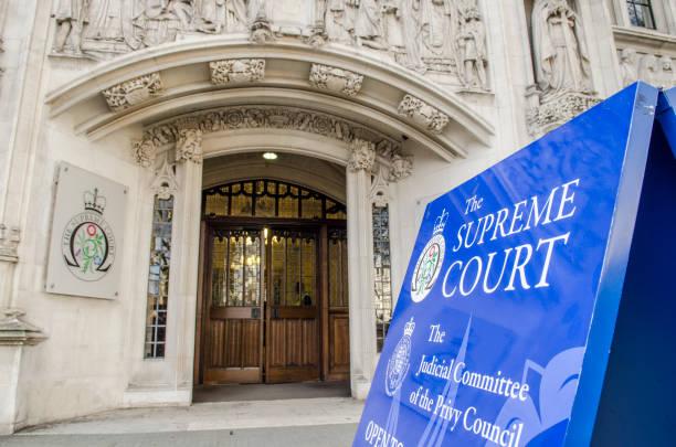 Corte Suprema, partiendo de la Plaza del Parlamento, Westminster, Londres - foto de stock