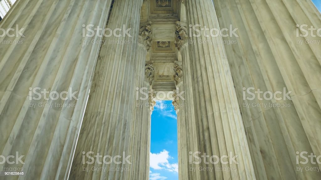 Supreme Court Columns Viewed from Below stock photo
