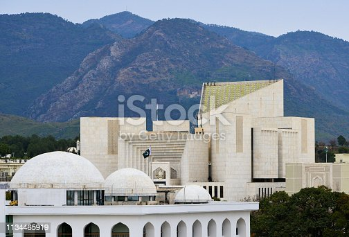 Islamabad, Pakistan: Supreme Court of Pakistan and Federal Shariat Court - secular and religious justice - Red Zone, Constitution Avenue - Modernist architecture - Mountains in the background