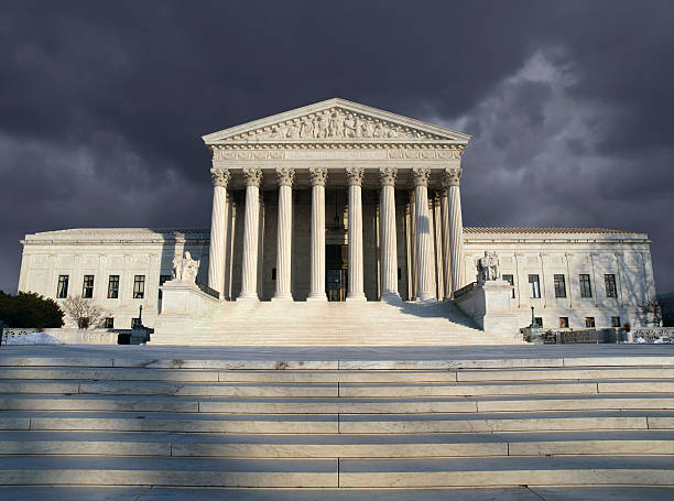 Supreme Court Storm Dark forbidding troubled storm sky over the United States Supreme Court building in Washington DC. us supreme court building stock pictures, royalty-free photos & images