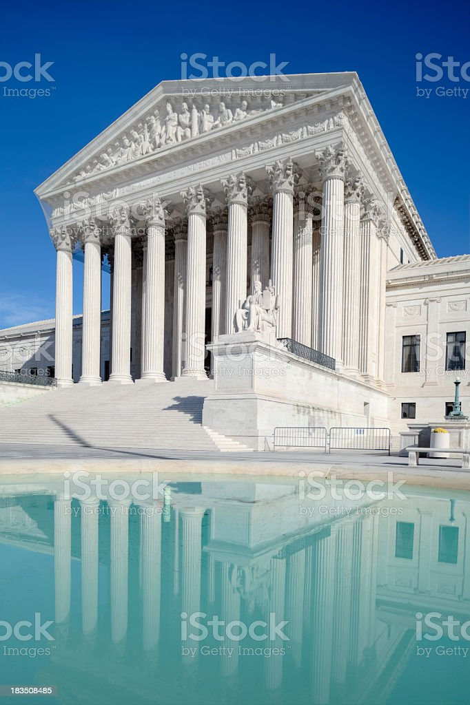U.S. Supreme Court with Reflection Under Clear Blue Sky royalty-free stock photo