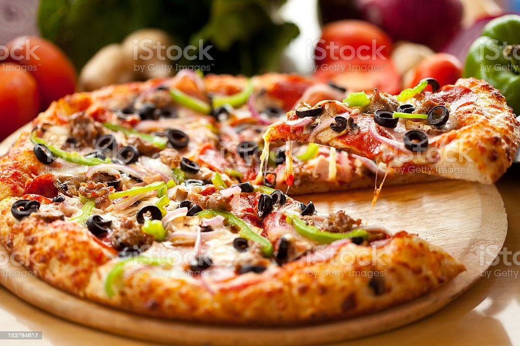 Supreme Pizza Slice lift royalty-free stock photo