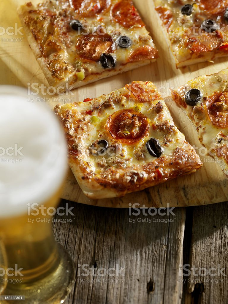 Supreme Pizza with a Beer stock photo