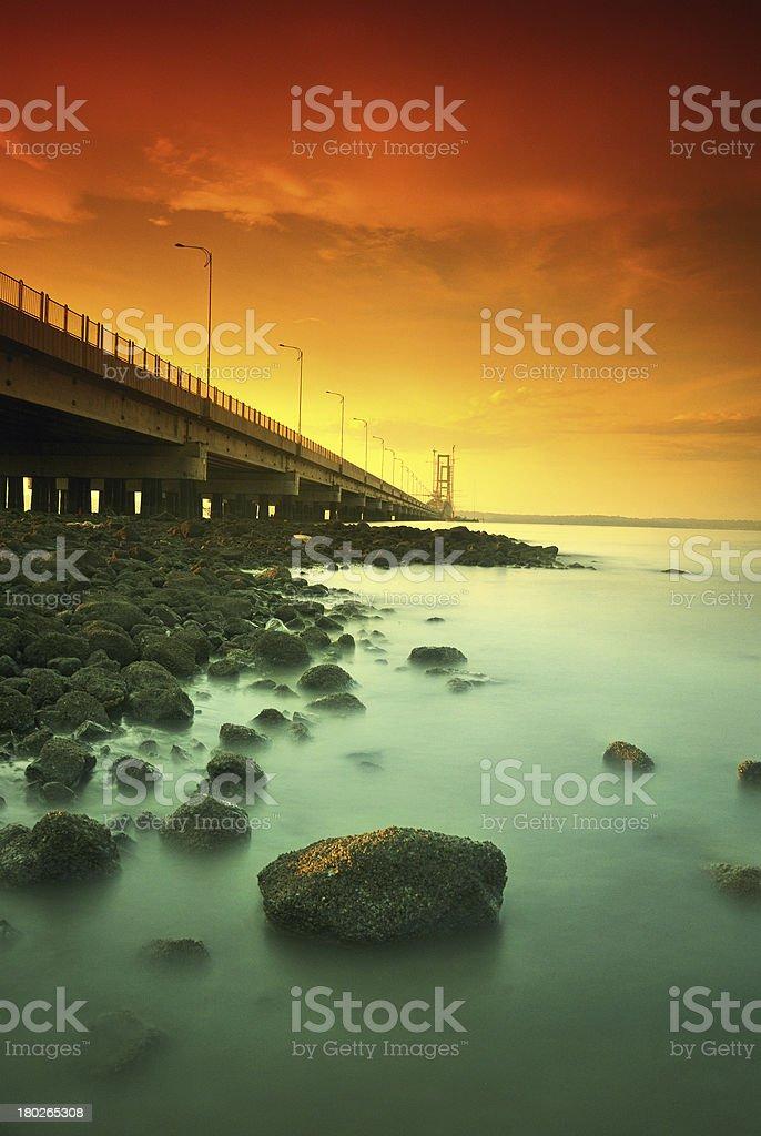 Suramadu bridge beside rocks royalty-free stock photo