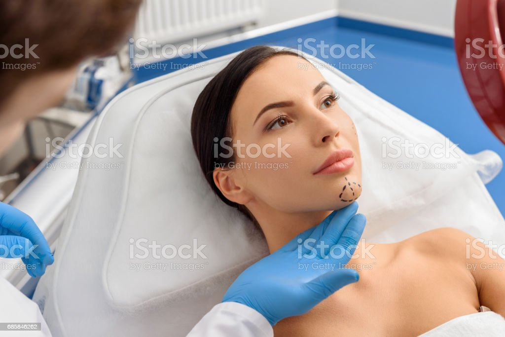 Sure woman looking at mirror before operation stock photo