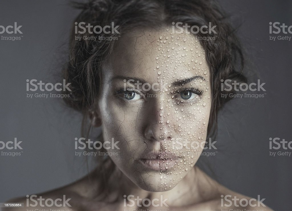 sureal portrait of beautiful women with wet and dry skin stock photo