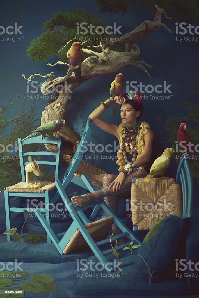 Sureal portrait of women with parrots stock photo