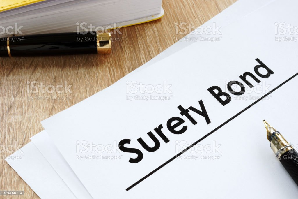 Surety bond form and pen on a table. stock photo