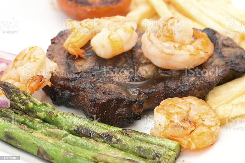 Surf and turf beef steak dinner royalty-free stock photo