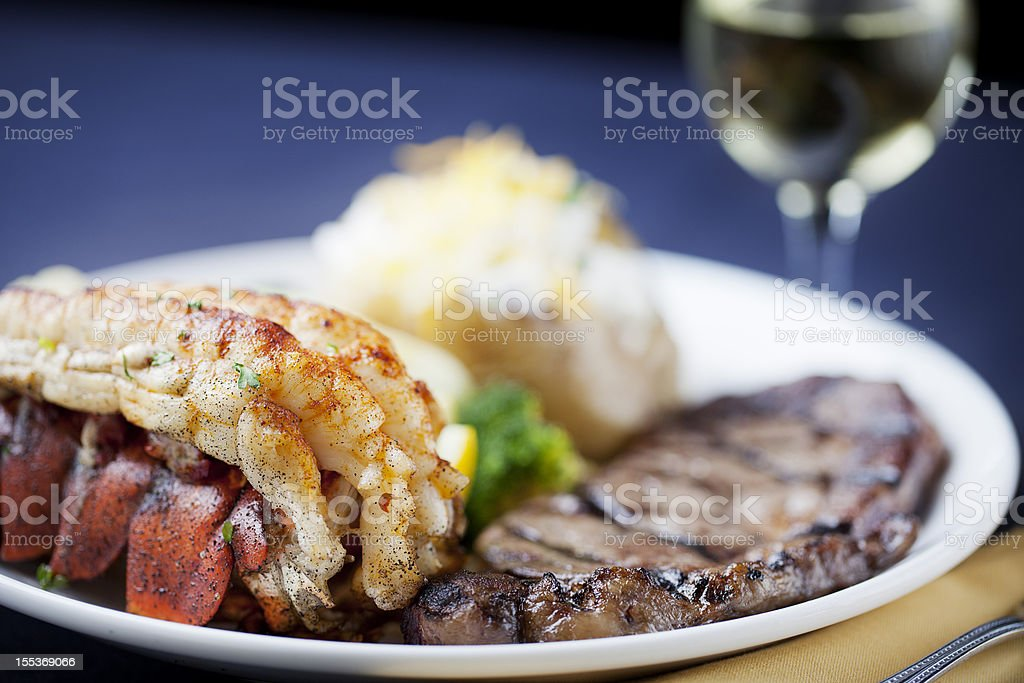 Surf and turf: dinner of steak, lobster tail stock photo